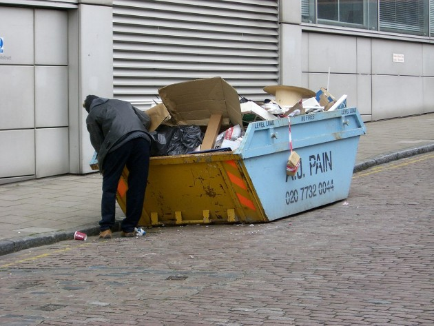 1200px-man_rummaging_thought_a_skip